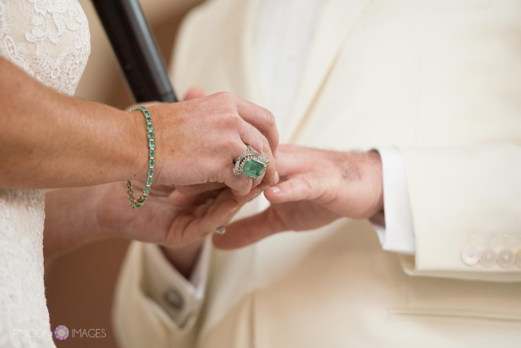 Bride and groom exchanging rings during their wedding ceremony.