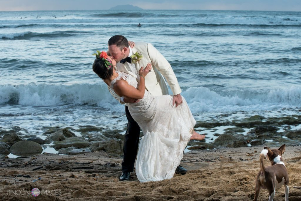 Wedding photograph of the bride and groom on the beach at sunset in Rincon, Puerto Rico