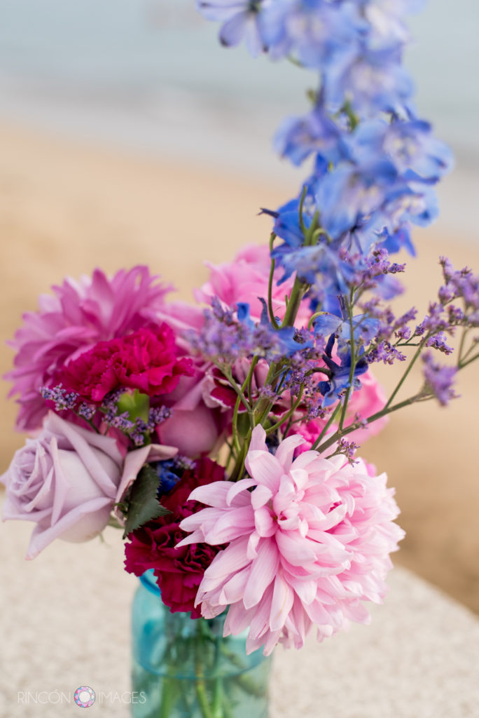 Teal vase with pink and purple wedding flowers.