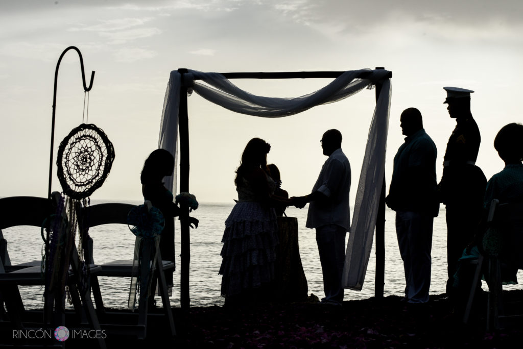 Silhouette photo of the ceremony on the beach in Rincon, Puerto Rico.
