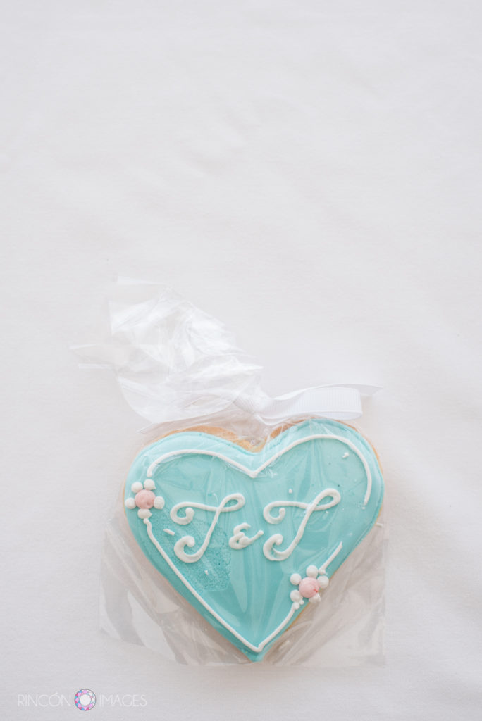 Turqouise blue cookie with the letters T&J