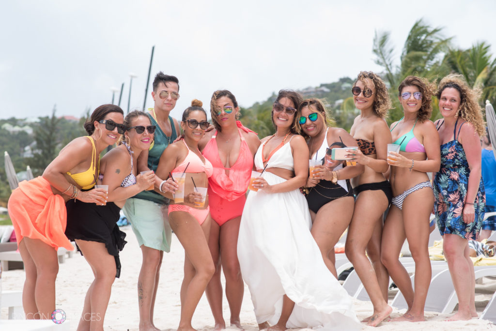 Bride and bridesmaids standing on the beach in St Barths