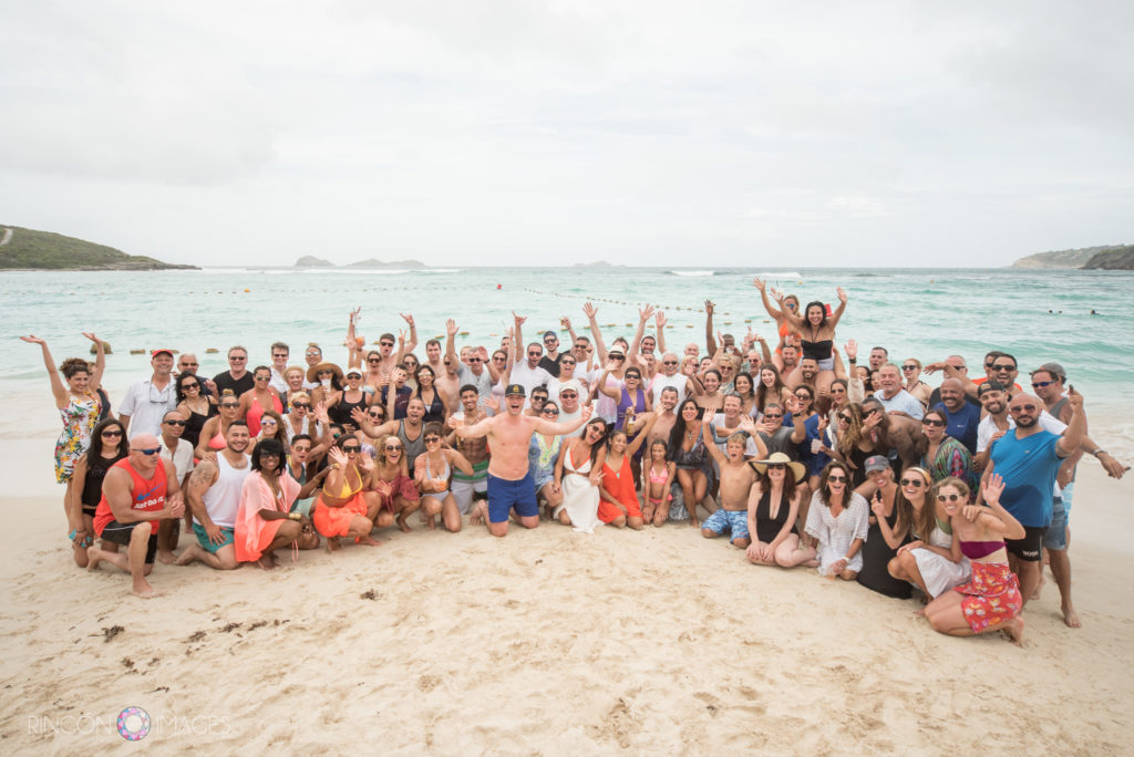 Large group photo of all the wedding guests and family on the beach in St Barths