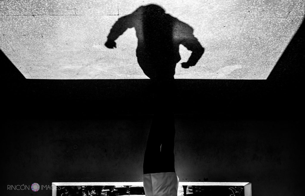 Creative wedding photograph of a grooms shadow. Black and white shadow photography