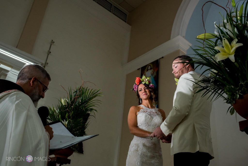 Bride and groom standing at the alter during their wedding ceremony