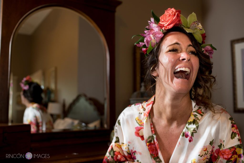 Wedding photograph of a bride laughing and wearing a flower crown at Marias in Rincon, Puerto Rico