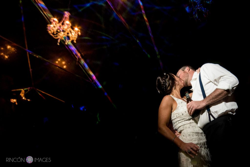 Wedding photograph of the bride and groom kissing during their wedding reception at Marias in Rincon, Puerto Rico