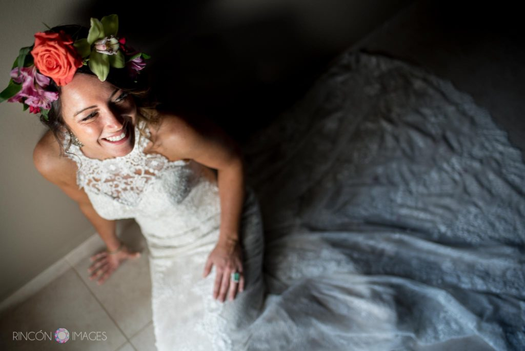 Natural light portrait of a bride sitting on the floor in a white wedding dress